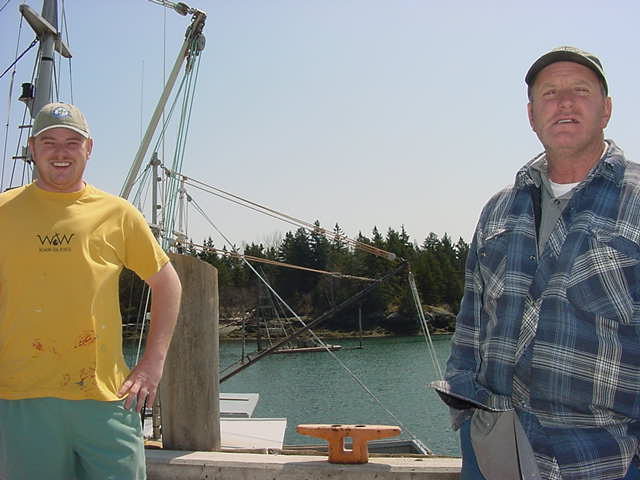Right Dana s brother who is mostly nicknamed Bimbo and his sun at the left, painting their boat.