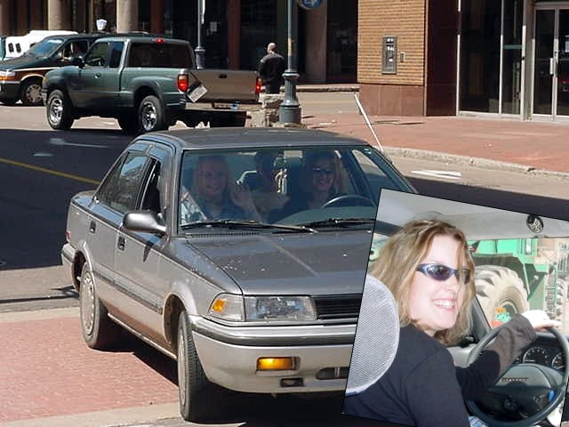 I awaited my next hostess at Assumption Plaza where a car drove by the first time, screaming and cheering at me, before it turned and pulled over at the sidewalk. My hostess Laurie Burns (behind the wheel) and her friends had arrived.
