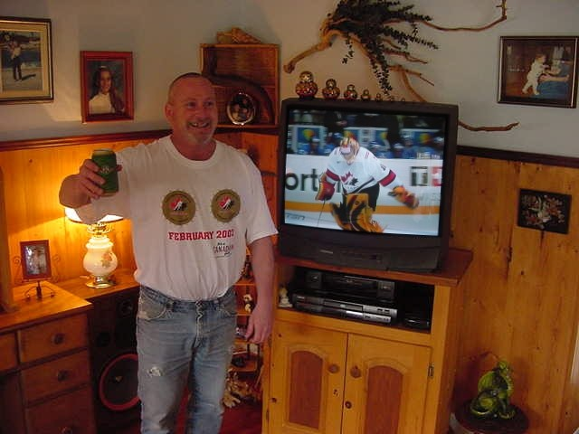 And here is Donald Sampson, enjoying a beer with hockey on television. He was happy, Canada won the world hockey championship from Sweden tonight!