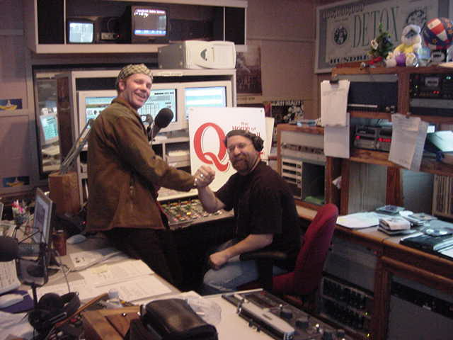 In the studio of Q104 where I was interviewed by morning host BJ. I even did the sports news on air!
