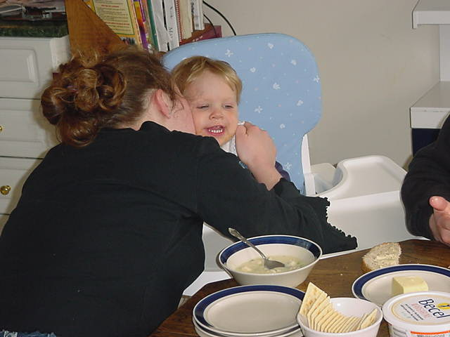 22-month-old Caleb already eats on his own, without help. Always worth an extra kiss from mommy!