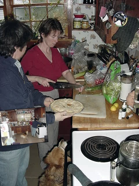 Carla and her partner Teresa are preparing dinner in the kitchen.