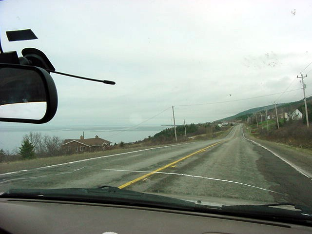 On the road I was intrigued by the scenery of forestry hills (or small mountains) that I saw on the other side of the Strait of Canso with the Bay of St. George at my left.