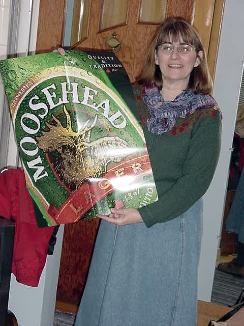 Mary Harris opened the mail today and look what she got. - Now why would they send me a poster of Moosehead Beer?