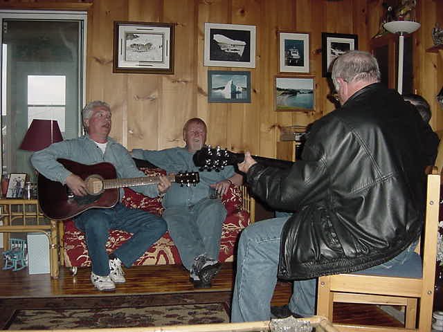 Hal (right) is a known musician and he started playing on his guitar. His friend on the couch jumped in...