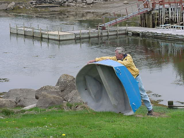 Back at the house, Bob topples his little peddle boat, to let the water out for the boat ride later today.