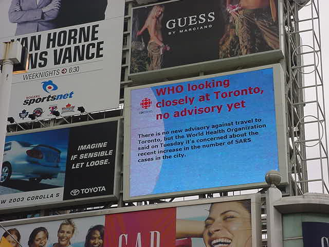 This big television screen above the new square at Yonge and Dundas Street told the latest news.