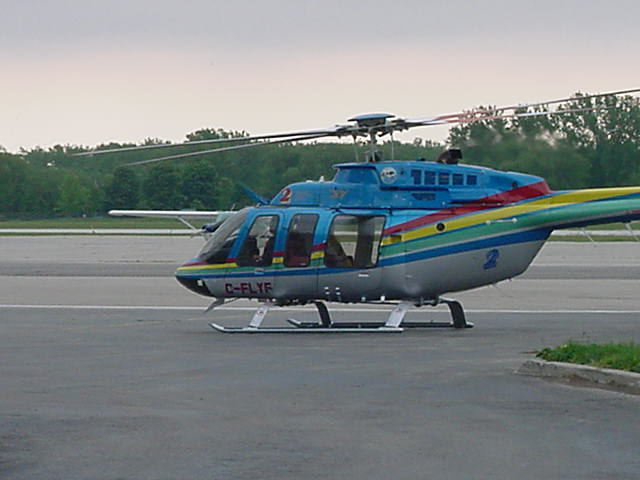 And there arrived Ruedi Hafen from Niagara Helicopters to pick up his new passengers.