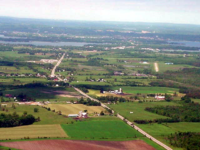 Orillia farmland, with the small city on the other side of the water.