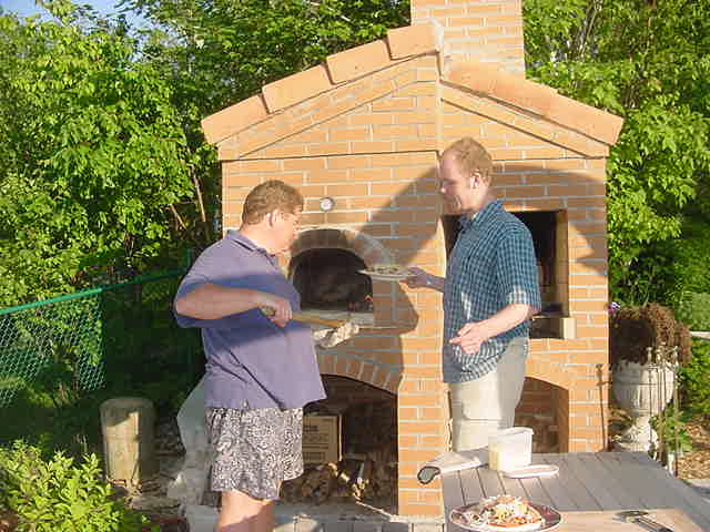 Richard really enjoyed baking the pizzas in that pizza oven.