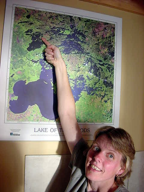 Claire points at a satelite photo Shoal Lake. It is very big. She is actually pointing at the spot we are currently at.