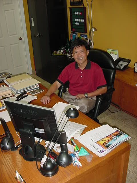 Andy behind his desk in his office.