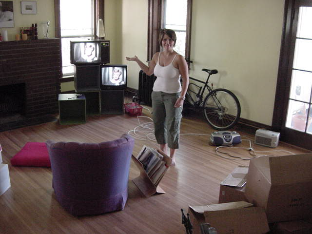 Andy dropped me off in front of the house where Michelle Kule lives. She actually just moved in this apartment and was just busy sorting things out. Her roommate Dave wants to create experimental television by putting more than one television in the corner.