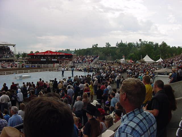 However the two men hosting the show, the ones with the microphones on the stage, would talk and hype it all up. When a cowboy fell off and couldn<#k#>'t get up, the audience was asked to clap him back on his feet again. And there would always be loud music to emphasise the pressure for the contestants.