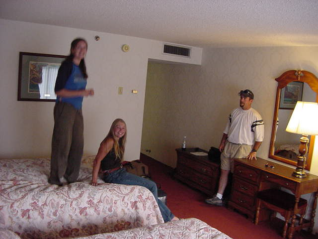 My hostess, her boyfriend and Karen dropped me off at the luxurious hotel, just a few streets from where I slept last night. They just loved the room I stayed in. I had two big beds, a television with Playstation games and a big bathroom. As you can see, Corinne had to test the beds for a sec.