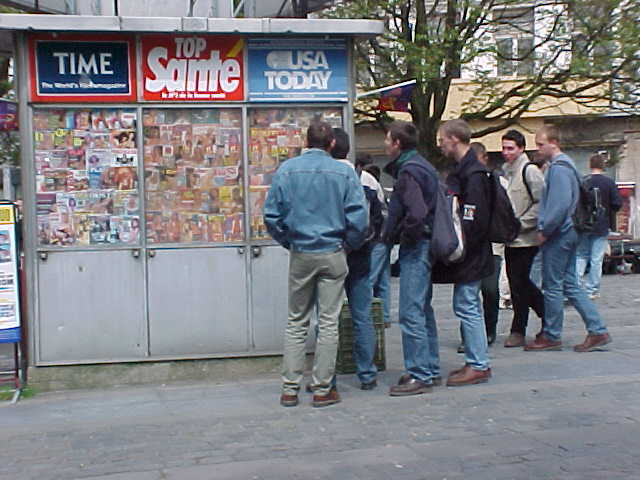 It was fascinating to see this group of Brittish schoolkids wander around this public porn booth, being totally amazed about all the magazines...