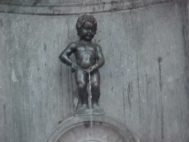 This is the famous weeing Manneke Pis. Occasionally he wears the traditional clothing of various countries, while peeing all day long...