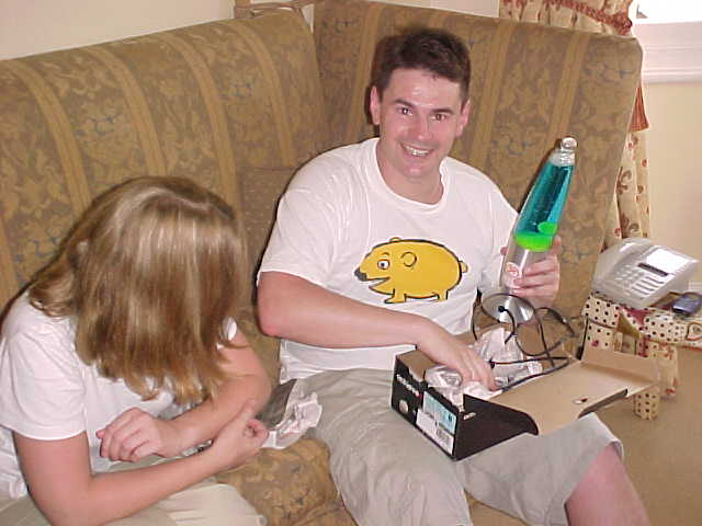 Evan and Rainne unpacking the gift from Paul: a lava-lamp!