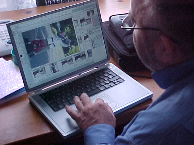 The photographer at Maria and Johns house in Enfield, editing his work, ready to send it to the picturedesk.
