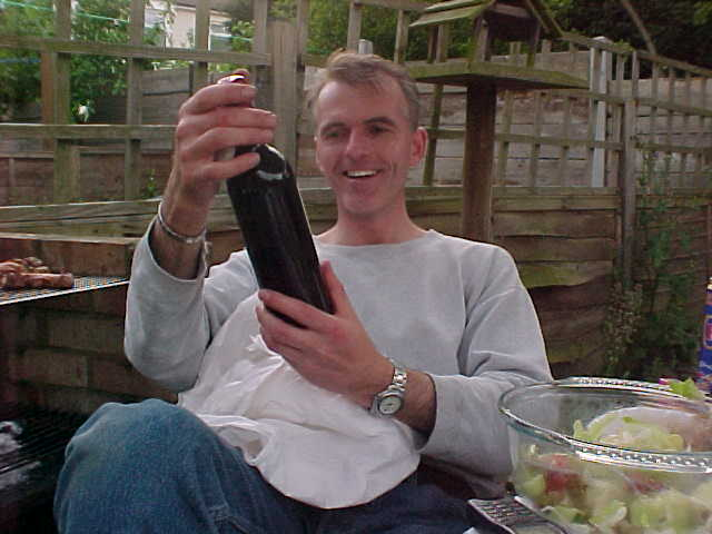 John got the bottle of New Zealand wine from Rainne and Evan...