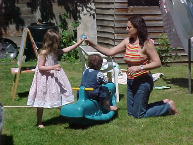 Maria playing with her kids Dante and Gabriella in her garden...