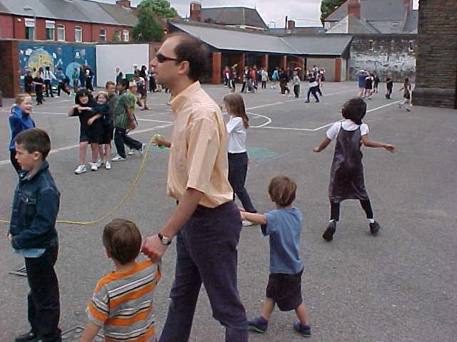 Daniele bringing his kids to the nursery school.