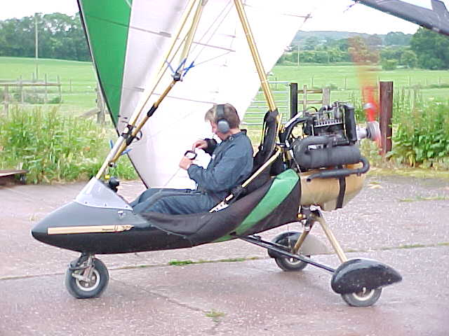 Nick warms up the engine of his microlight plane.
