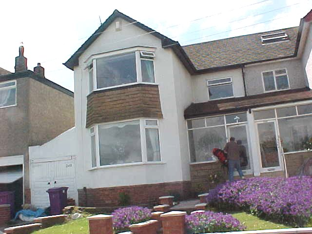 The house in Childwall, Liverpool. On the photo Andy carrying my backpack...