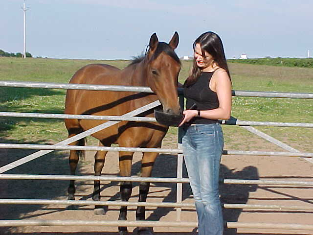 This is Suzanne with her 2-years-old horse.