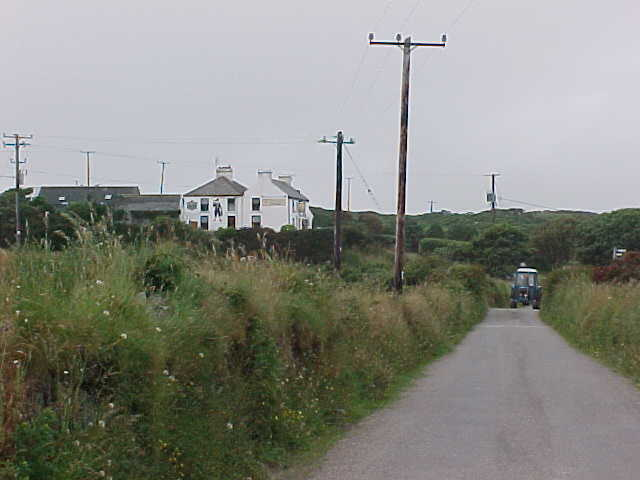 Walking on one of the rare roads on Shenklin Island, with a pub on the left...