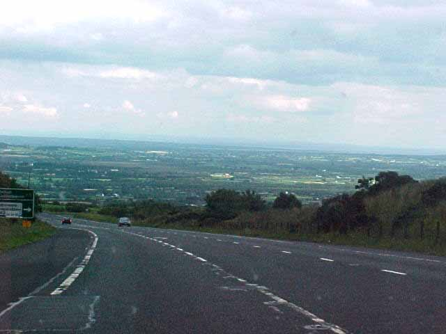 On the road towards Belfast, at the right you can see the Lough Neagh, the biggest lake in Europe. Behind that lays Belfast.