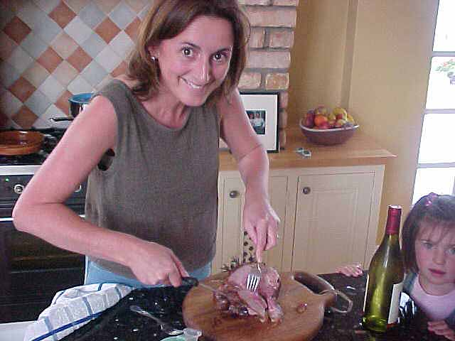 Carol cutting lamb meat for dinner...
