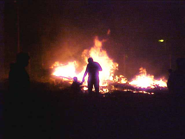 Very strange to see this man takes his little son along the Belfast bonfires...