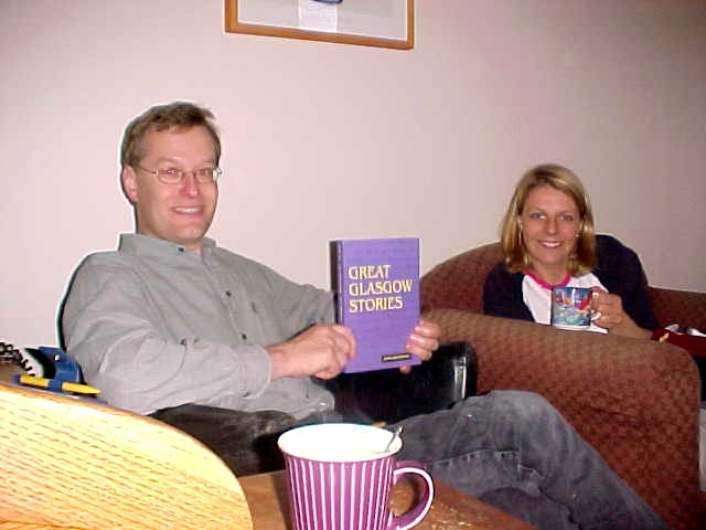 Jos and Annemarie with the present from Alan: the book The Great Glasgow Stories!