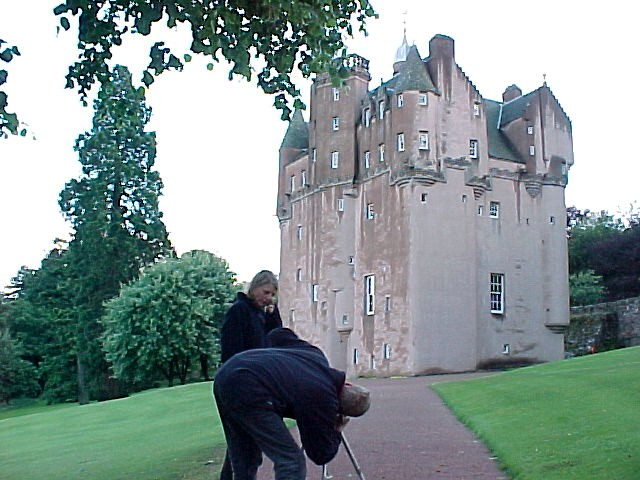 After dinner at the haunted Craigievar Castle. Jos is setting up a place for a picture.
