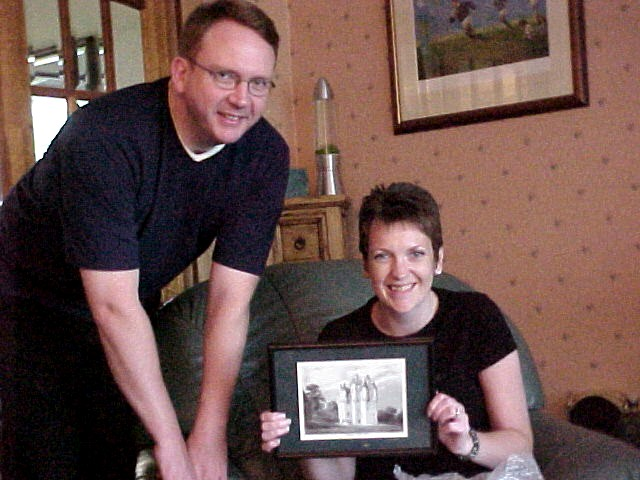 Fraser and Elaine with the present from my hosts in Forbes. By the way: who framed the Cairgievar Castle?