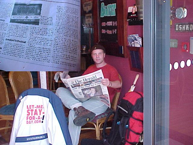 Me reading the Herald at the Filling Station.