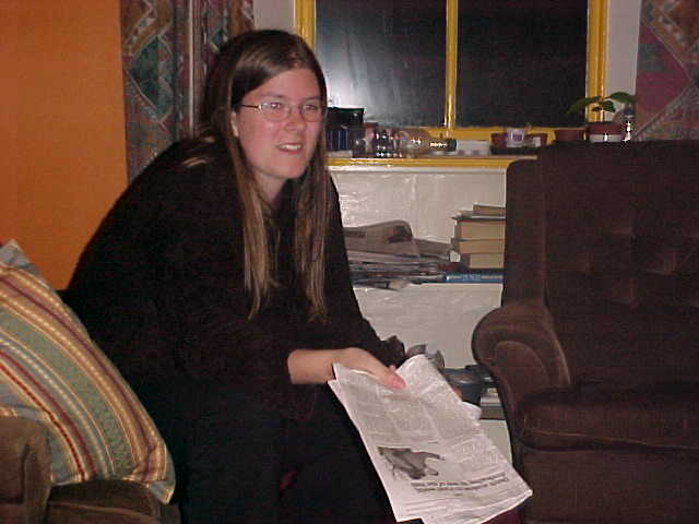 One of the flatmates, Katie reading about me in the USA TODAY!