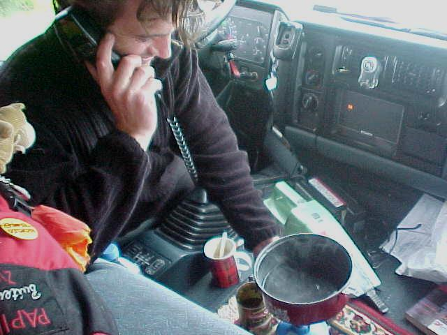 And while waiting at a traffic light, making a phonecall while heating up some water with a gas kit to make a cup of coffee!