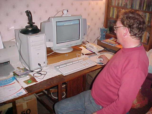 Douglas behind his computer...