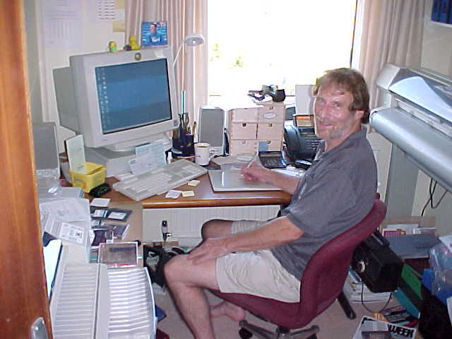 My next host Chris Raymond in Maidenhead, behind his computer in his home office.