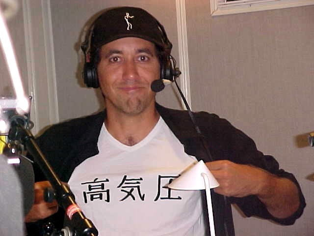 The host of High Pressure, the programme on DR Radio P3, with the same name in Chinese (?) on his shirt.