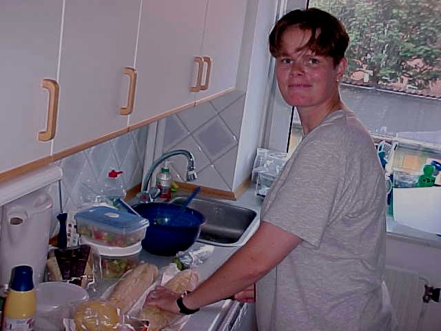 Ingrid van Vliet prepares some sandwiches for the beach...