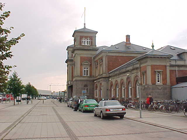 The Aalborg train station on the John F. Kennedy Plads...
