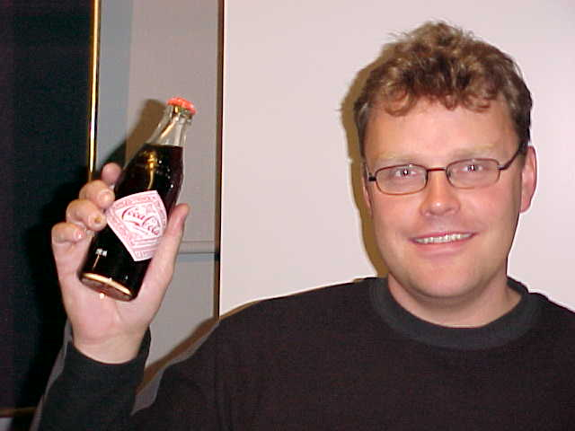 Erik Berstad with his present from my hosts in Stavanger, a unique Coca Cola bottle from the 100 years anniversary of Coca Cola.